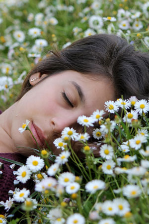 woman sleeping on back in grass with head turned sideways