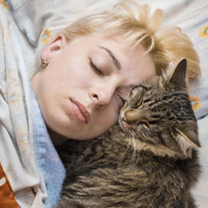 woman taking nap with cat