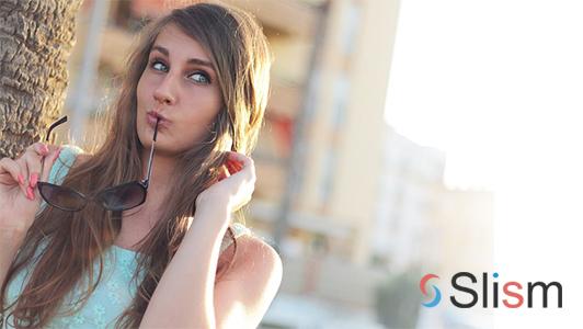 girl biting sunglasses