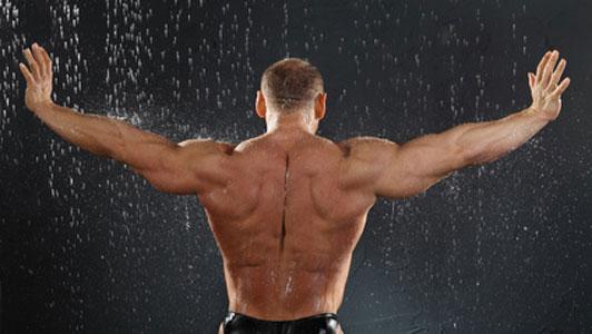 muscular guy back in the rain