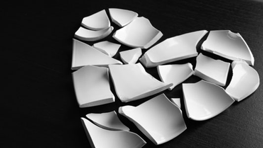 white heart shaped plate on black surface broken