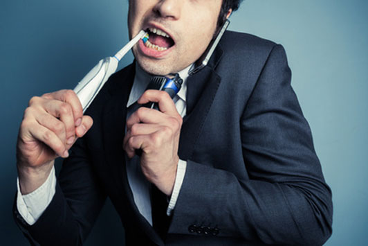 guy brushes teeth while talking