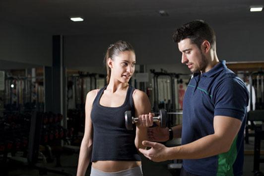 guy helping girl workout